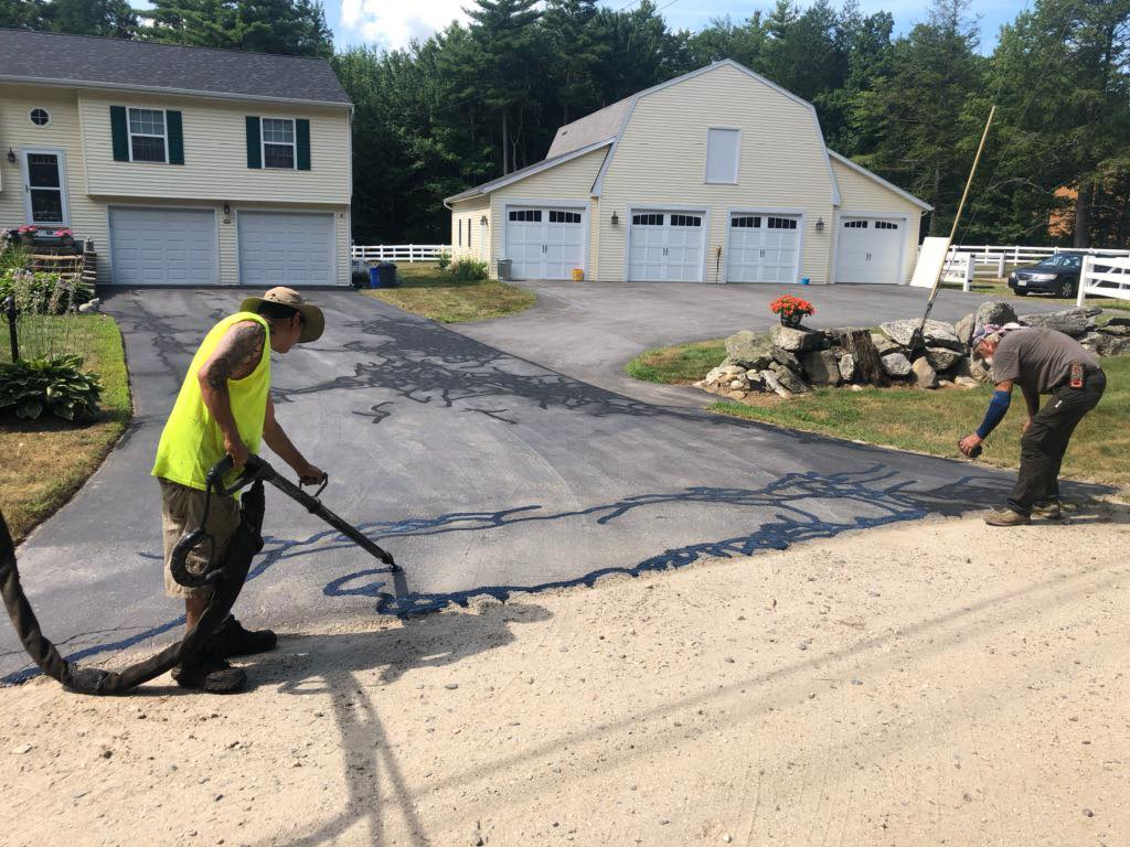 Crack Sealing a driveway in Maine
